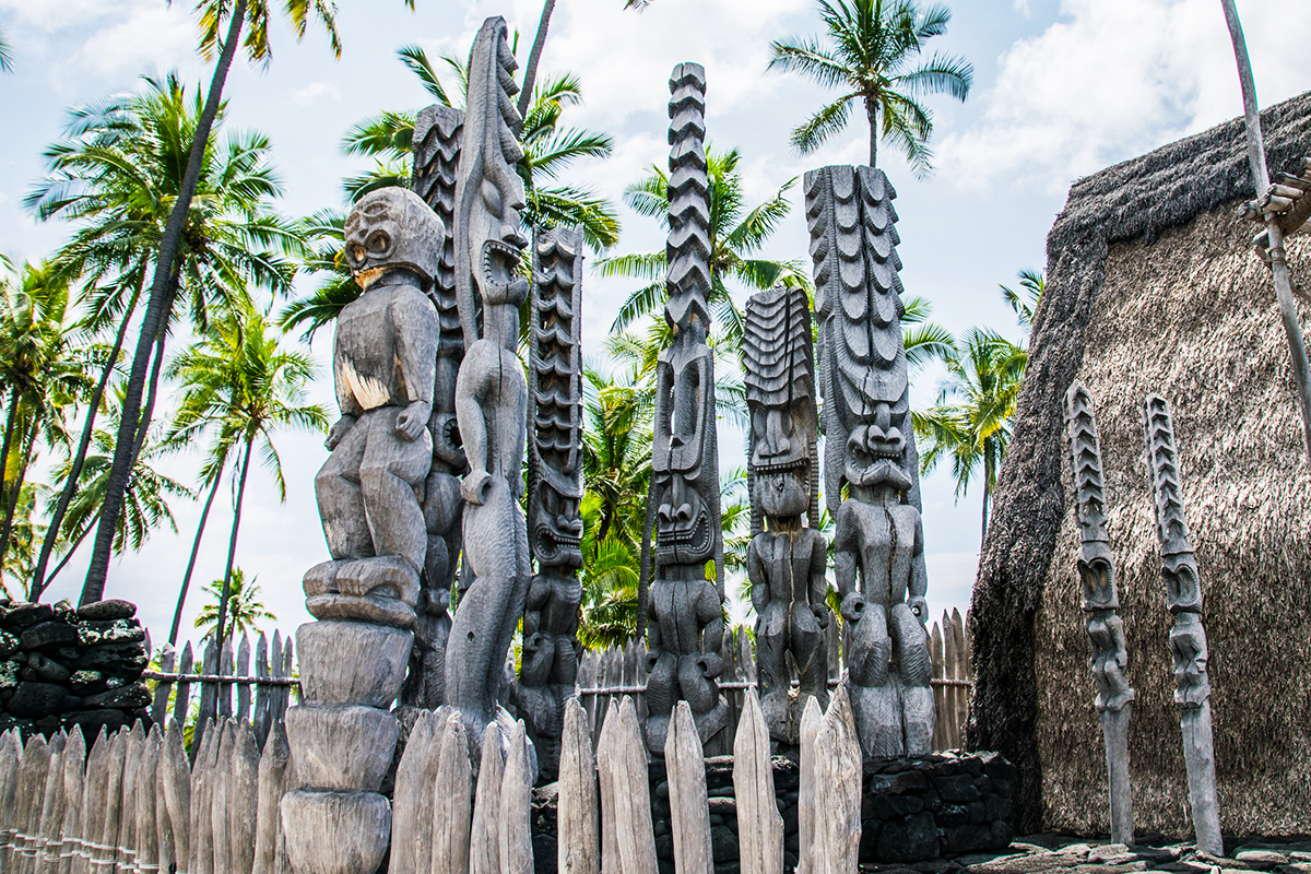 Statues greet visitors to Puuhonua O Honaunau