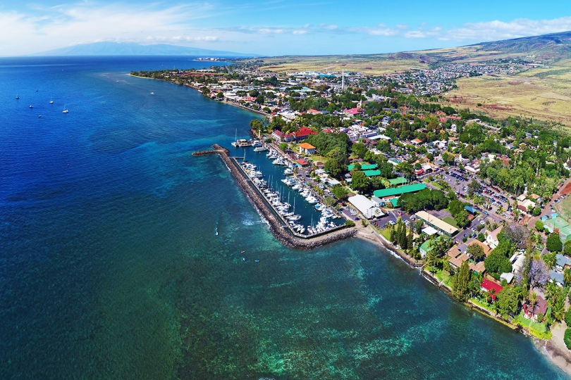 An aerial shot of Lahaina showing the harbor